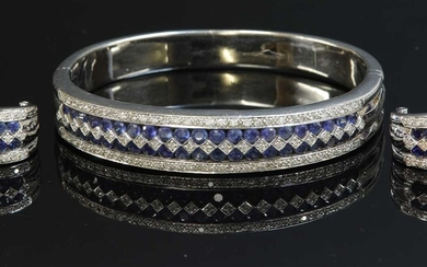 A white gold sapphire and diamond hinged bangle and earring suite