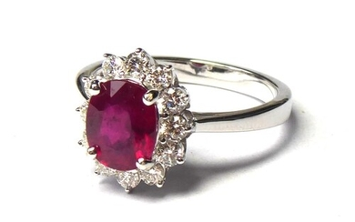 AN 18CT WHITE GOLD, RUBY AND DIAMOND RING An oval cut ruby e...