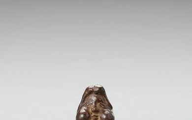 AN UNUSUAL ROOT WOOD MASK NETSUKE OF OKAME