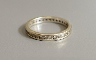American wedding band in 18 karat white gold...