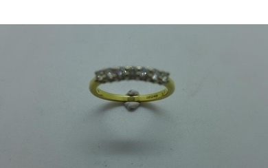 An 18ct yellow gold diamond set half eternity ring set with ...