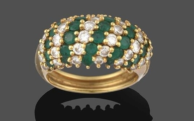 An Emerald and Diamond Ring, formed of eleven alternate rows...