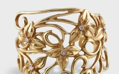 An eighteen karat gold and diamond cuff bracelet