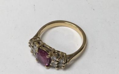 An unmarked 18ct gold and pink sapphire and diamond ring, 4....
