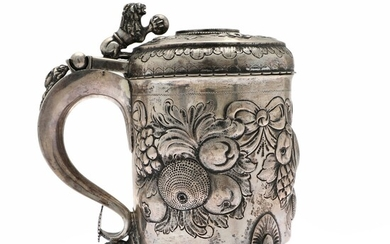 Baroque style silver tankard. Pseudo marks. 19th century. Weight 1060 g. H. 21 cm.