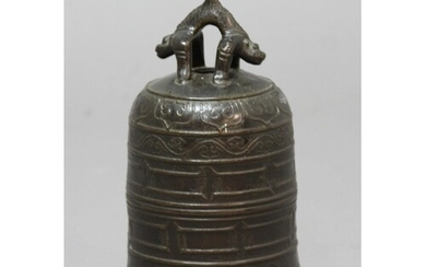 CHINESE BRONZE BELL, of archaistic form, a twin dragon loop ...