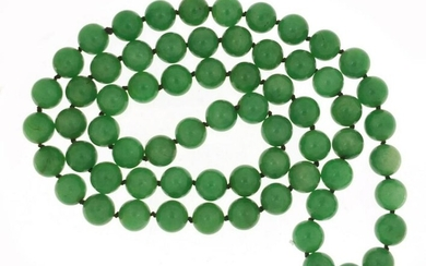 Chinese green jade bead necklace, 84cm in length