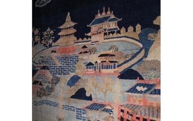 Chinese rug woven with a landscape design in shades of blue,...