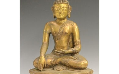 Chinese/Tibetan School (19th century), a gilt bronze Buddha,...