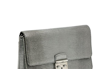 Christian Dior - a silver embossed leather handbag.
