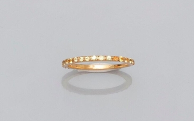 Fine yellow gold wedding band, 750 MM, highlighted with yellow sapphires, beautifully crafted, size: 54, weight: 2.15gr. gross.