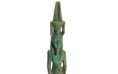 Large amulet representing the God Nefertum standing with his arms along his body.
