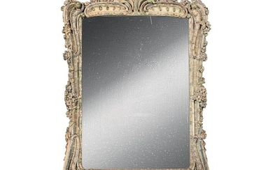 Large mirror in a wooden frame partially gilded...