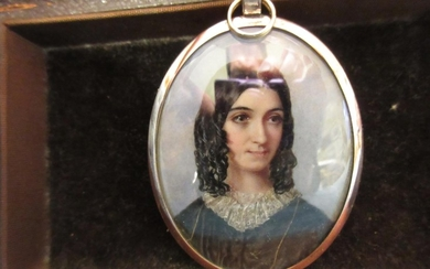 Mid 19th Century miniature oval portrait of a young lady wit...