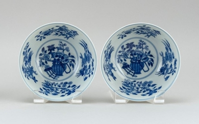 PAIR OF CHINESE BLUE AND WHITE PORCELAIN BOWLS In bell form, with a flower basket design surrounded by floral sprays. Six-character...
