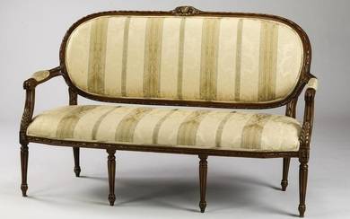 Parcel gilt Louis XVI style settee in striped damask