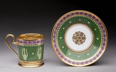 SEVERED. Mug and its saucer in hard porcelain, polychrome and gold decoration. The cup is decorated with musical instruments painted in pale green monochrome on a green background of chrome legends. The saucer is decorated with a rosette of gold...