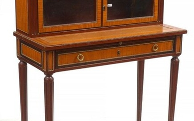 Small Louis XVI style lady's writing desk in curly mahogany veneer with a magnifying glass door opening by two glass doors in the upper part and fitted with a drawer in the belt. Gilded bronze gallery and ornamentation. Yellow marble shelf. Period: end...