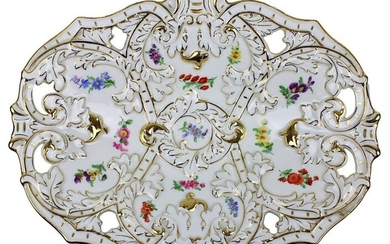 Splendid bowl, Meissen c. 1950, ovoid shape, decorated with gold and colour, partly open-worked rim, leaf tendrils and ribbons in relief, scattered flower decoration, blue sword mark on the bottom, 1st choice, stamp no. C.168 and 96 and 102, incised...