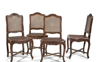 Suite of four dining room chairs in waxed natural wood....