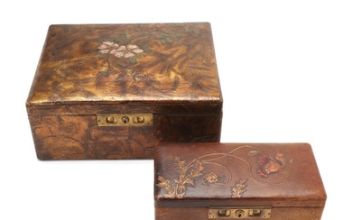Two art noveau leather boxes with embossed flowers, partly coloured one box gilt. C. 1900. L. 25,5–33 cm. H. 8–13 cm. D. 13–27 cm. (2)
