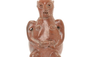Western Mexico seated naked woman figure of red fired clay with hat, hands holding on stomach. 800–1500. H. 19 cm.
