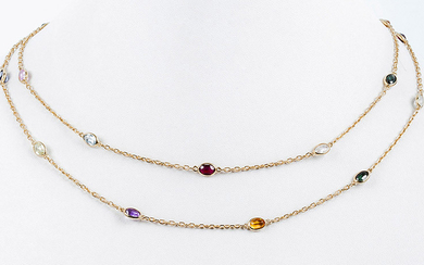 Yellow gold necklace formed by a solid double...