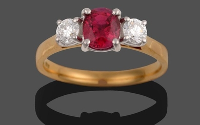 An 18 Carat Gold Ruby and Diamond Three Stone Ring,...