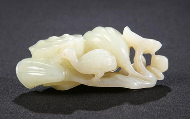 A CHINESE CELADON JADE CARVING, carved with a bird and