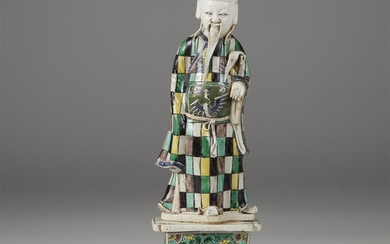 A Chinese famille verte porcelain figure of a deity...