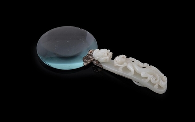 A Chinese pale celadon jade belt hook adapted as a magnifying glass