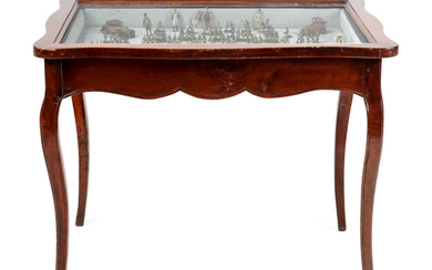 A Collection of Miniature Lead Soldiers in a Louis XV Style Vitrine Table