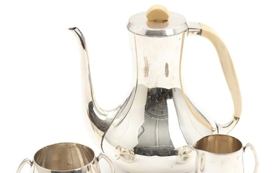 A. F. Rasmussen: A three-piece sterling silver coffee set comprising coffee pot with ivory handle and finial, and sugar bowl and creamer. H. 6.5–21 cm. (3)