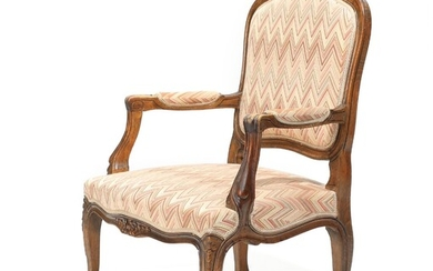 NOT SOLD. A French early 20th century stained beech Rococo style armchair with curved armrests...