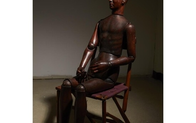 A French life-size carved mahogany articulated artist's lay figure...