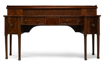 A George III mahogany and crossbanded serving table, the top...