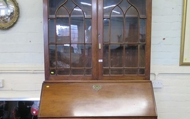 A George III mahogany bureau bookcase, with ogee arched glaz...