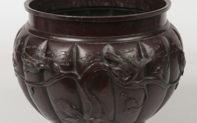 A Japanese Meiji period patinated bronze planter of lobed fo...