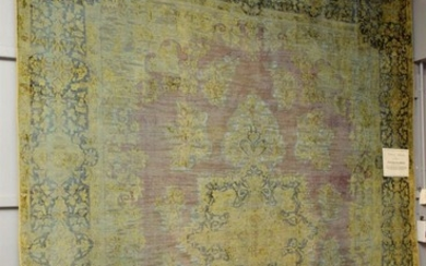 A LARGE AND UNIQUE MODERN VINTAGE OVER DYED AND HAND CARVED PERSIAN KERMAN CARPET CREATED FROM A HAND KNOTTED VINTAGE PERSIAN KERMAN...