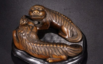 A PAIR BAMBOO LIONS PLAYING BALL ORNAMENTS