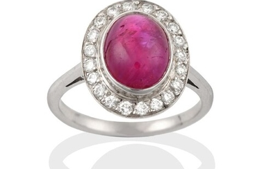A Ruby and Diamond Cluster Ring, the cabochon ruby in...