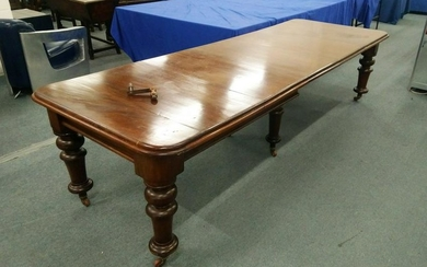 A VICTORIAN MAHOGANY EXTENDING DINING TABLE, with three