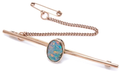 A VINTAGE 9CT ROSE GOLD OPAL BAR BROOCH; centring a rub set opal doublet (chipped around edges, between tapered upswept shoulders, s...