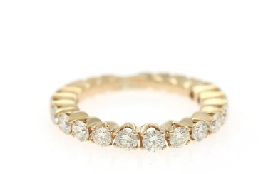 A diamond eternity ring set with numerous brilliant-cut diamonds weighing a total of app. 1.25 ct., mounted in 14k gold. W. 2.7 mm. Size 49.