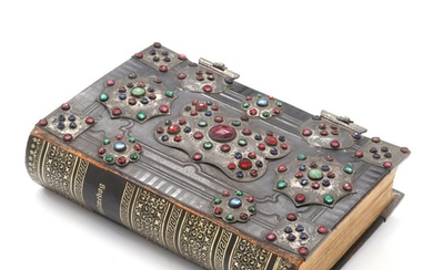 A hymnal with silver mountings and clasps with numerous coloured glass stones. 19th century. H. 19.5. L. 13 cm.