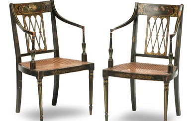 A pair of George III ebonised and floral painted open armchairs