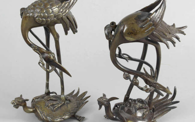 A pair of Oriental bronze animalier figures.