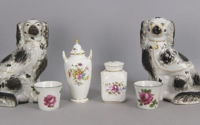 A pair of Staffordshire pottery spaniels, 19th...