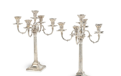 A pair of Victorian silver candelabra