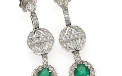 NOT SOLD. A pair of emerald and diamond ear pendants each set with an oval-cut...
